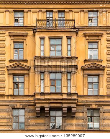 St. Petersburg Russia - May 16 2016: Several windows in a row and bay window on facade of the Saint-Petersburg University of Economics front view