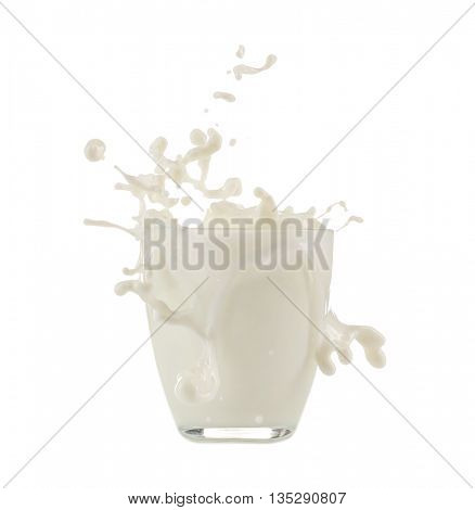Glass with splashing milk isolated on white