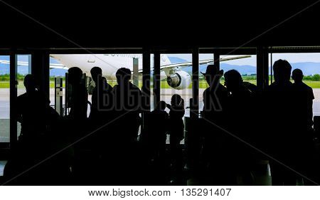 Silhouette of people waiting on airport