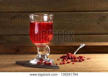 Glass Healing Infusion of Goji Berries and Dried Goji Berries nearby.