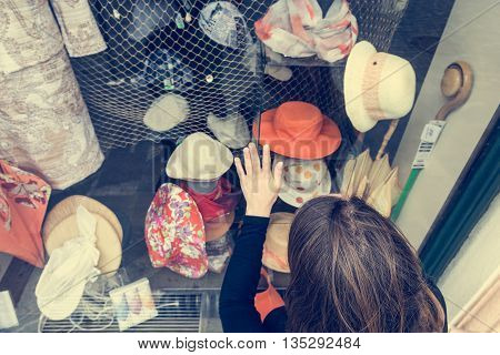 Attractive brunette window shopping. Overhead view of a shopper