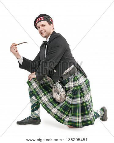 Scottish Man In Traditional Costume With Smoking Pipe