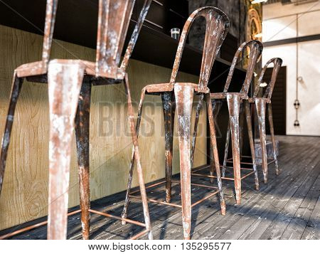 3d illustration of interior design loft style. The picture shows the bar stools retro