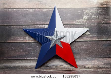 The star of the Texas flag against a wood background