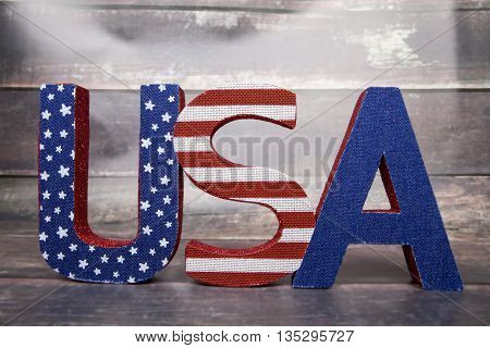 An U.S.A. decoration for Independence Day against a wood background