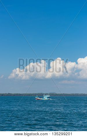 Fishing boat float on the sea with blue sky in Gulf of Thailand. Suitable for use as wallpapers.