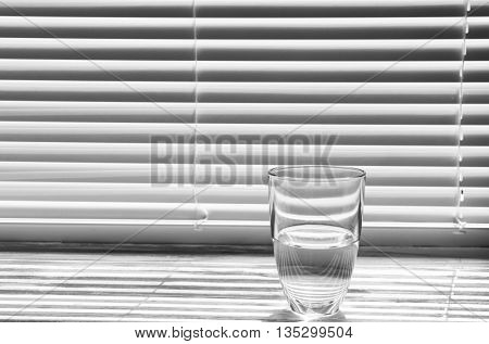 Glass of pure water on the windowsill
