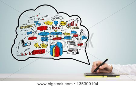 Hand of designer man working with tablet and business sketches at background