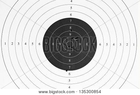 Used paper target with a bullet holes.