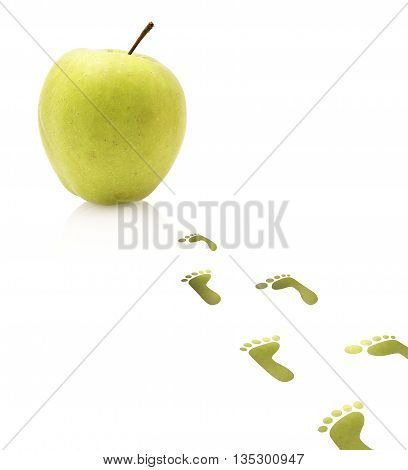 Foot steps are leading towards and apple.