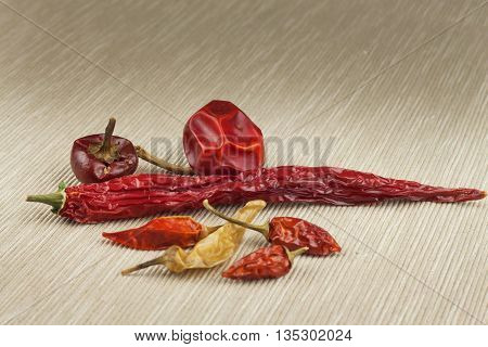 Different kinds of dried chili peppers. Dried red chili peppers. Hot spices to food.