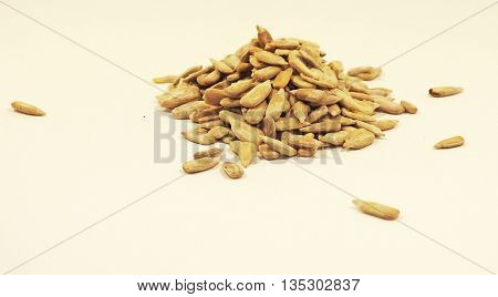 Isolated separated sunflower seeds on white background
