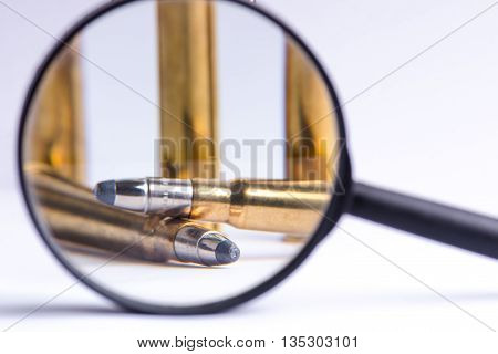 Ammunition on a white background. View through a magnifier. Isolated. Close up. Weapons. Bullets