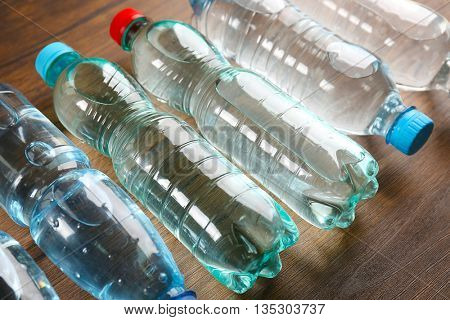 Bottled water on the wooden table, close up
