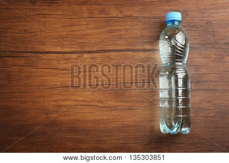 Bottled water on the wooden table, top view