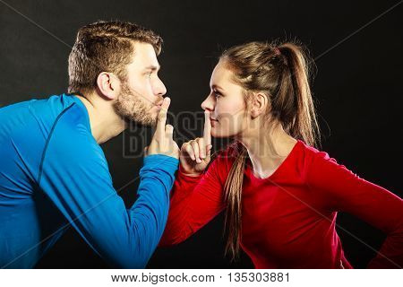 Couple Asking For Silence With Finger Gesture.