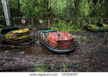 abandoned cars in Pripyat park, Chernobyl, Ukraine