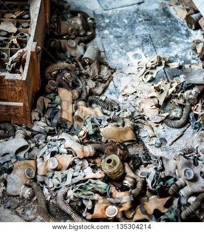 abandoned school room with trash and masks on the floor in Pripyat, Chernobyl, Ukraine