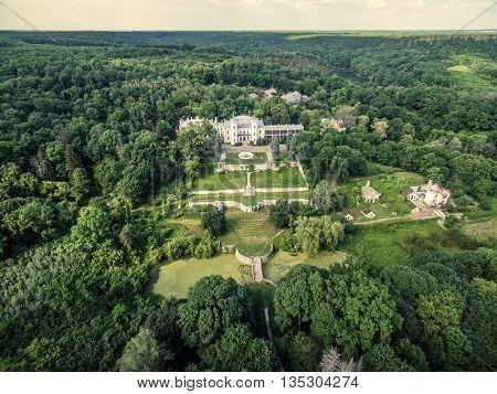 beautiful aerial view on White Swan palace and yard in Sharivka park, Kharkiv region, Ukraine