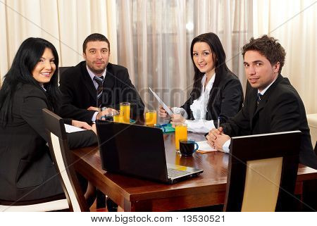 Happy Business People Around A Table At Meeting