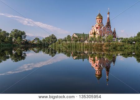 Reflection of a church in the water, Almaty, Kazakhstan.
