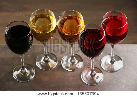 Glasses with wines of different colors on a table