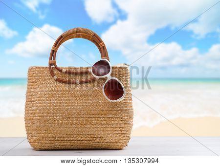 Beach bag with sunglasses ready for the beach