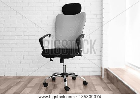 New office chair on the brick wall background