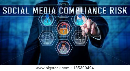 Manager is pushing SOCIAL MEDIA COMPLIANCE RISK on an interactive touch control screen. Business challenge metaphor and information technology concept for the pitfalls of corporate social networking.