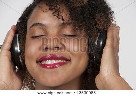 Beautiful Woman Listening To Headphones