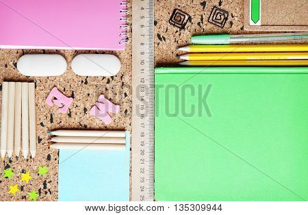 Stationery on cork desk background