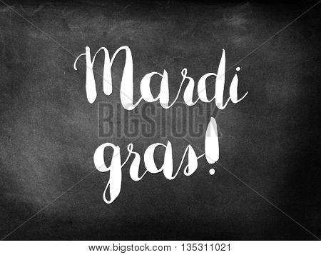 Mardi gras written on chalkboard