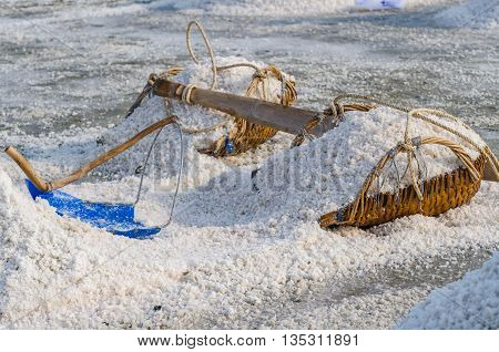 Heap of sea salt on the hod for harvest into barn at salt field in Samut Songkhram province Thailand. Selective Focus.