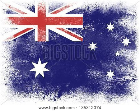 Powder paint exploding in colors of Australia flag isolated on white background. Abstract particles explosion of colorful dust.