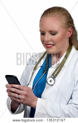 Woman medical doctor using a cell phone to text