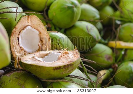 Coconut divided in half on a heap of coconuts. Selective Focus. Suitable for use as wallpapers.
