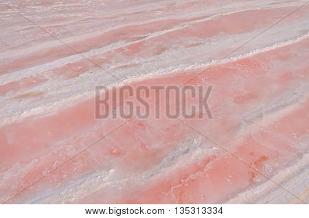 Sea water is evaporated it begin to crystallize and change color is pink. Nature Background.