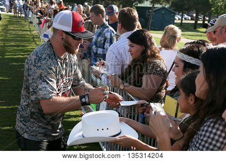ARLINGTON, TX - APR 18: Recording artist Brantley Gilbert signs autographs for fans at the ACM & Cabela'??s Great Outdoor Archery Event at the Texas Rangers Youth Ballpark on April 18, 2015.