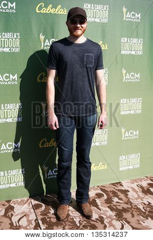 ARLINGTON, TX - APR 18: Eric Paslay attends the ACM & Cabela'??s Great Outdoor Archery Event during the 50th Academy Of Country Music Awards at the Texas Rangers Youth Ballpark on April 18, 2015.