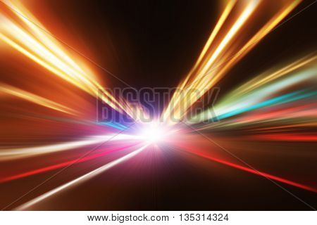 Motion blurred image of traffic lights on the road at night.