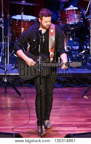 NASHVILLE, TN-SEP 1: Randy Houser performs onstage during the 9th Annual ACM Honors at the Ryman Auditorium on September 1, 2015 in Nashville, Tennessee.