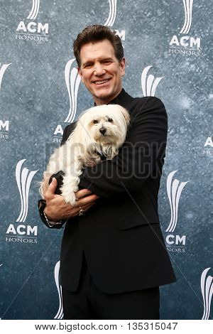 NASHVILLE, TN-SEP 1: Chris Isaak and his dog, Rodney, attend the 9th Annual ACM Honors at the Ryman Auditorium on September 1, 2015 in Nashville, Tennessee.