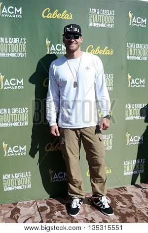 ARLINGTON, TX - APR 18: Chase Rice attends the ACM & Cabela'??s Great Outdoor Archery Event during the 50th Academy Of Country Music Awards at the Texas Rangers Youth Ballpark on April 18, 2015.