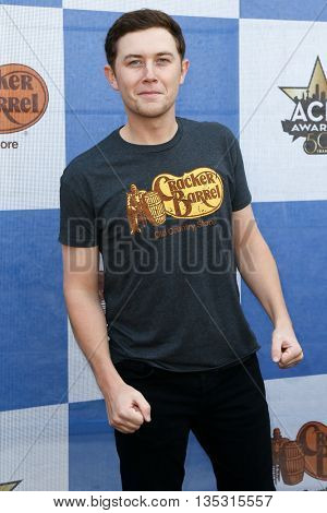 ARLINGTON, TX - APR 18: Singer Scotty McCreery attends the Cracker Barrel Old Country Store Country Checkers Challenge at Globe Life Park in Arlington on April 18, 2015 in Arlington, Texas.