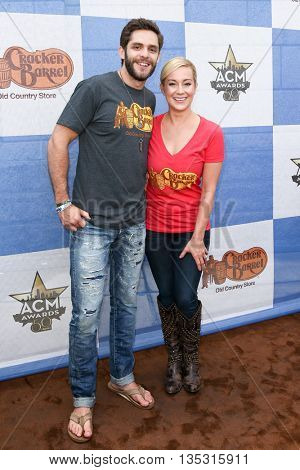 ARLINGTON, TX - APR 18:Thomas Rhett (L) and Kellie Pickler attend the Cracker Barrel Old Country Store Country Checkers Challenge at Globe Life Park in Arlington on April 18, 2015 in Arlington, Texas.