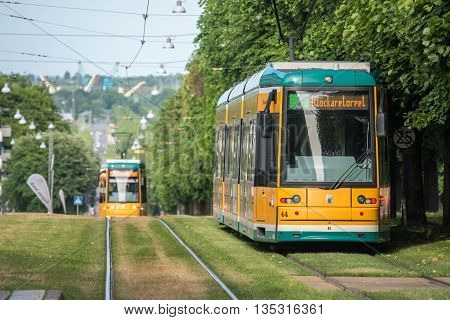 NORRKOPING, SWEDEN - JUNE 19, 2016: The iconic yellow trams of Norrkoping. Norrkoping is a historic industrial town in Sweden.