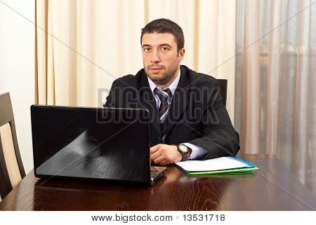 Serious Manager With Laptop