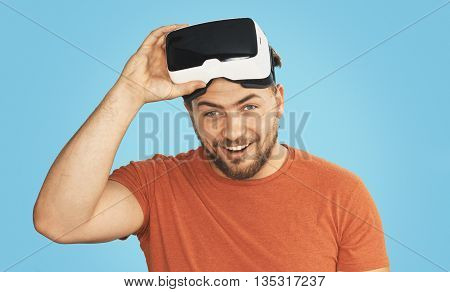 Young man wearing virtual reality goggles, VR Glasses