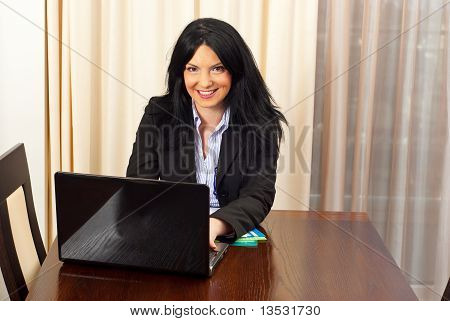 Beautiful Business Woman In Office Working