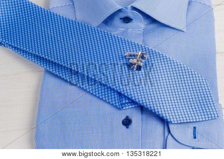 Striped Folded Shirt With A Tie Isolated On White Background